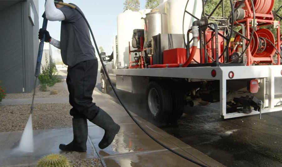 Glide Rite Power Washing Technician Spraying Concret