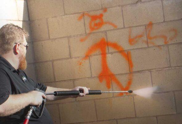 Services_Glide-Rite-Power-Washing-Technician-Spraying-Graffiti_Removal
